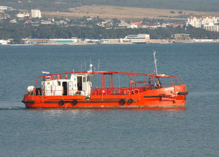 boat crew: Gelendzhik, Russia - September 8, 2010: Rescue boat with its crew on deck on patrol at the harbor