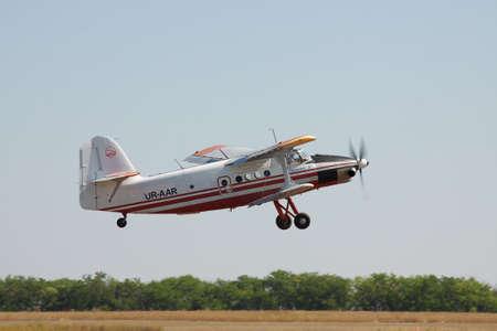turboprop: Odessa, Ukraine - August 27, 2011: Antonov An-3 turboprop biplane is taking off from the airfield