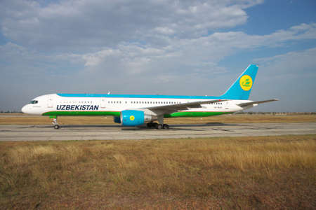 airways: Simferopol, Ukraine - September 13, 2010: Uzbekistan Airways Bowing 757-200 is taxiing along the taxiway in the airport