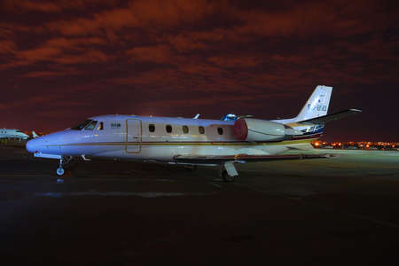 cessna: Kiev, Ukraine - March 27, 2011: Cessna 560XL Citation Exel business jet during the night in the airport