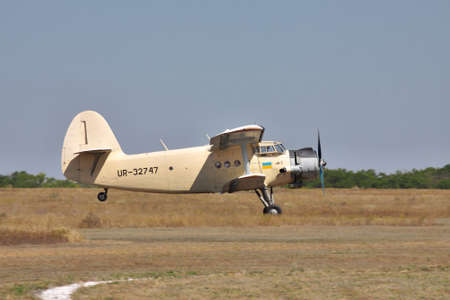 airfield: Odessa, Ukraine - August 27, 2011: Antonov An-2 biplane is taking off from the airfield