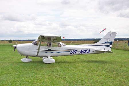 cessna: Zhitomir, Ukraine - July 31, 2011: Cessna 172 Skyhawk parked on the grass airfield