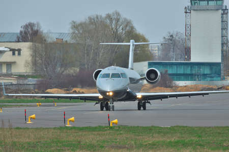 bombardier: Kiev, Ukraine - April 14, 2012: Bombardier Challenger 850 Business Jet is taxiing to the runway for takeoff