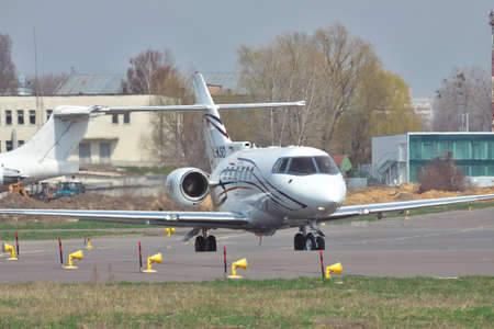 hawker: Kiev, Ukraine - April 14, 2012: Hawker 850XP business jet is taxiing to the runway for takeoff