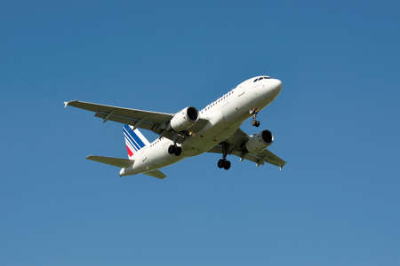 airbus: Borispol, Ukraine - June 9, 2011: Air France Airbus A319 is landing against blue sky in summer