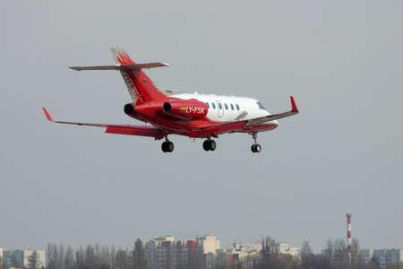 hawker: Kiev, Ukraine - April 14, 2012: Hawker 900XP Business Jet is landing in the city