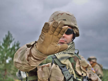iraq: US Army soldier raises his hand in order to stop you do something Stock Photo