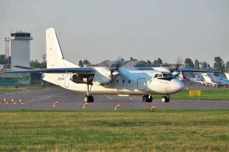 turboprop: Kiev, Ukraine - July 27, 2012: Antonov An-24 turboprop passenger plane is taxiing to the runway before takeoff Editorial