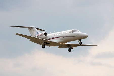 cessna: Kiev, Ukraine - July 31, 2012: Cessna 525A CitationJet CJ2 business jet is landing with cloudy sky on the background Editorial
