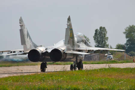 Kiev Region, Ukraine - August 3, 2012: Ukraine Air Force MiG-29 is taxiing to the runway for a training flight Editorial