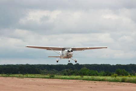 xp: Zhitomir, Ukraine - July 31, 2011: Cessna 172S Skyhawk XP is taking off from runway into cloudy sky for a leisure flight