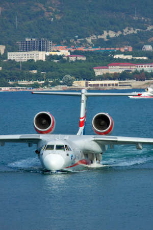 animals amphibious: Gelendzhik, Russia - September 8, 2010: Beriev Be-200 amphibian plane is getting out of the water to land on the ramp Editorial