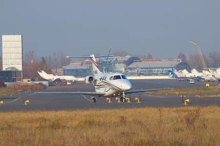 premier: Kiev, Ukraine - November 5, 2011: Raytheon 390 Premier business jet is taxiing along the apron in the airport