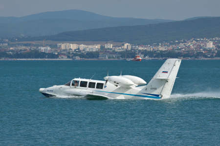 hydroplane: Gelendzhik, Russia - September 8, 2010: Beriev Be-103 amphibious plane is taking off from water surface of the bay