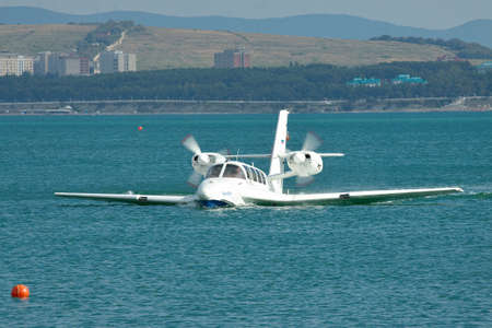 hydroplane: Gelendzhik, Russia - September 8, 2010: Beriev Be-103 amphibious plane after landing on the water surface of the bay
