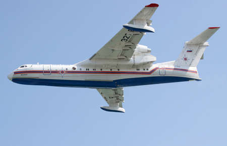 hydroplane: Gelendzhik, Russia - September 9, 2010: Beriev Be-200 amphibian plane is flying against blue sky Editorial