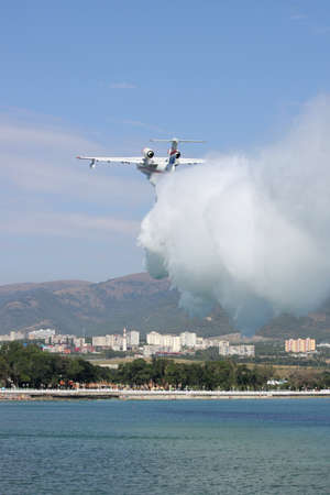hydroplane: Gelendzhik, Russia - September 9, 2010: Beriev Be-200 amphibian planes is dropping a load of water to show its firefighting abilities Editorial