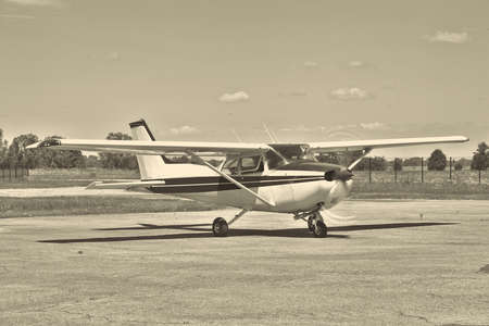 airfield: Light private plane on the airfield preparing for a leisure flight - black and white image Stock Photo