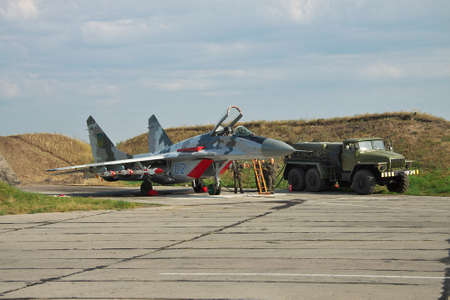 Vasilkov, Ukraine - August 3, 2012: Ukrainian Air Force Mig-29 fighter plane is being prepared for a training flight with its weapons attached Editorial