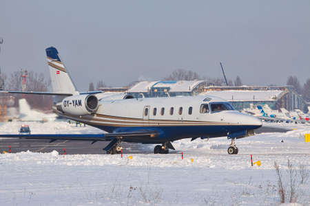 Kiev, Ukraine - January 27, 2012: IAI 1125 Astra business jet is taxiing to the runway for takeoff on a winter day