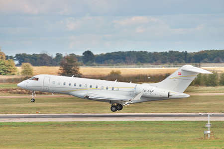 bombardier: Borispol, Ukraine - October 2, 2011: Bombardier BD-700-1A10 Global Express XRS business jet a moment before the touchdown