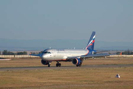 reversing: Simferopol, Ukraine - September 12, 2010: Aeroflot Airbus A320 reversing the engines on the runway after landing
