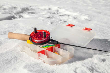 jig: Ice fishing rod and box with lures  Stock Photo