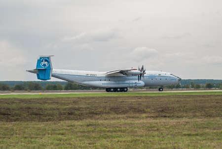 Kiev Region, Ukraine - September 25, 2008: Antonov An-22 turboprop cargo plane is taking off from the runway