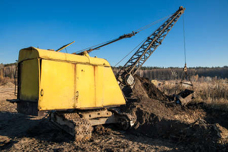 Old dragline excavator on the peat extraction site Stock Photo