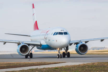 Borispol, Ukraine - October 23, 2011: Austrian Airlines Airbus A319-112 taxiing in the airport for takeoff on a cloudy day Editorial