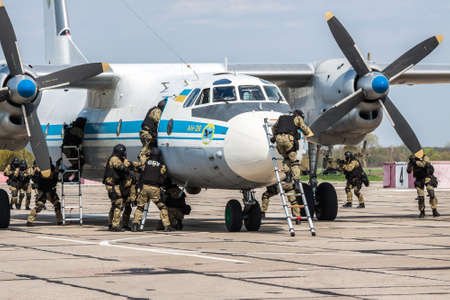 Kiev Region, Ukraine - April 24, 2012: Special counter-terrorist forces train to rescue the hostages and assault the plane captured by the terrorists Editorial