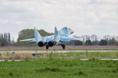 Kiev Region, Ukraine - April 24, 2012: Ukraine Air Force Aero MiG-29 jet fighter is taking off from the airbase for another flight on cloudy day