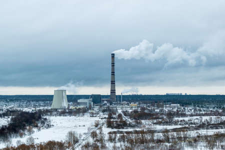 Combined power plant on a cloudy winter day with some snow on the ground