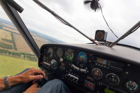 View from the cockpit of a light plane during a leisure flight on a cloudy day