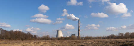 Heat power plant on the horizon on a sunny day pano image