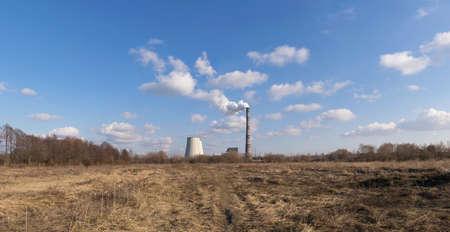 Heat power plant rising on the horizon on a sunny day pano image Stock Photo