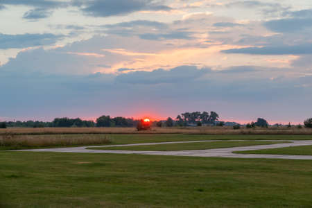 Sunset over a small private airfield in the country