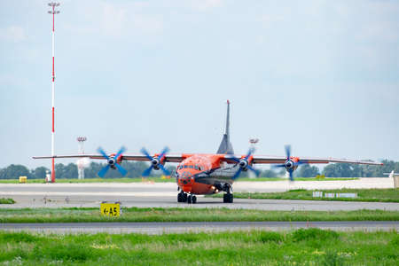 Kyiv Region, Ukraine - August 1, 2018: Antonov An-12 cargo plane is taxiing to the runway in the airport Redakční