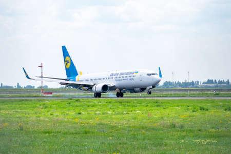 Kyiv Region, Ukraine - August 1, 2018: Ukraine international Airlines Boeing 737 is touching down on landing in the airport Redakční