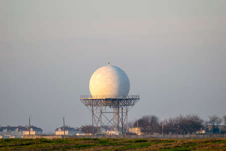 Airport air traffic radar tower on sunset