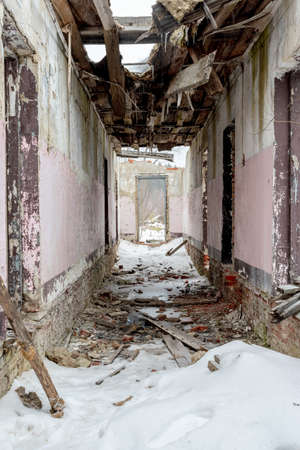 Abandoned building ruins and interior with cracked walls