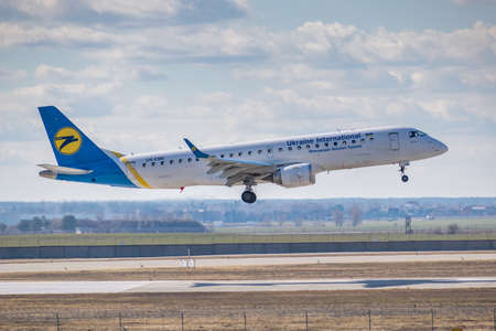 Kyiv, Ukraine - March 17, 2019: Ukraine International Airlines Embraer ERJ-190 on short final landing in the airport Редакционное