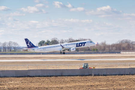 Kyiv, Ukraine - March 17, 2019: LOT Polish Airlines Embraer ERJ-195 on short final landing in the airport