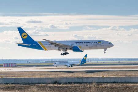 Kyiv, Ukraine - March 17, 2019: Ukraine International Airlines Boeing B777 on short final landing in the airport