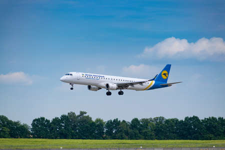 Boryspil, Ukraine - August 3, 2019: Ukraine International Airlines Embraer-195 is langing in the airport