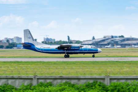 Kyiv, Ukraine - June 9, 2019: Motor Sich Antonov An-24 passenger plane is taking off from the airport Sajtókép