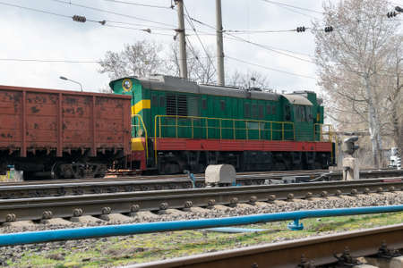 Diesel locomotive with cargo train on the track