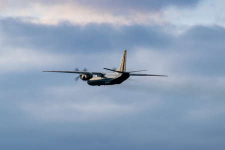 Turboprop cargo plane is taking off on sunset Stock fotó