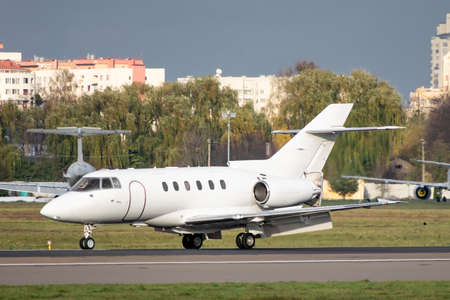Business jet with reverse scoops released on runway