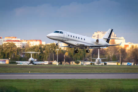 Busines jet is taking off from runway in the airport Stock fotó